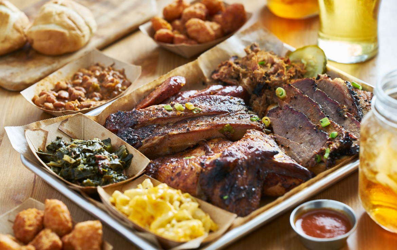 bbq tray with smoked brisket ribs pork chicken hot links collard greens tea