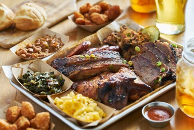bbq tray with smoked brisket ribs pork chicken hot links collard greens tea